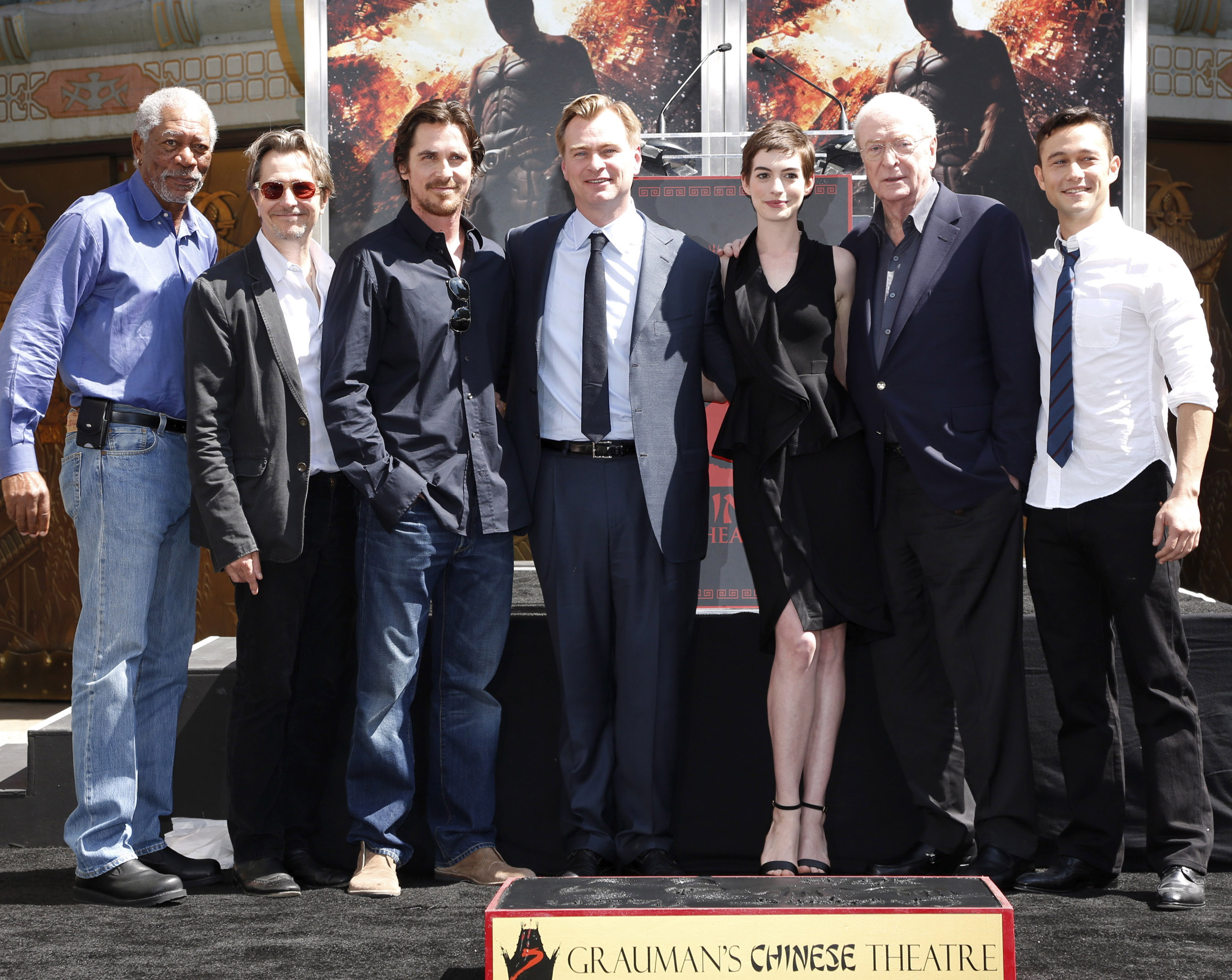 """L-r: From of Warner Bros. Pictures' and Legendary Pictures' """"THE DARK KNIGHT RISES,"""" MORGAN FREEMAN, GARY OLDMAN, CHRISTIAN BALE, CHRISTOPHER NOLAN, ANNE HATHAWAY, MICHAEL CAINE and JOSEPH GORDON-LEVITT at the ceremony honoring director/writer/producer CHRISTOPHER NOLAN, whose hand and footprints were placed in the forecourt of Grauman's Chinese Theatre in Hollywood. """"THE DARK KNIGHT RISES"""" is a Warner Bros. Pictures release."""